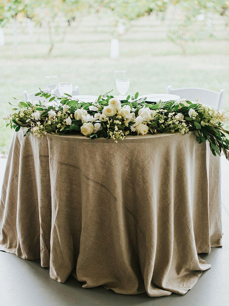 Rustic sweetheart table centerpiece idea