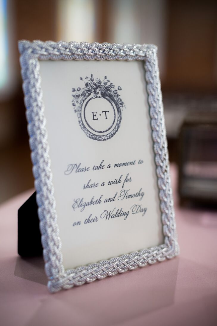 Elizabeth designed and printed all the stationery herself including the navy and white guest book sign. The sign was framed in a silver braided design for a chic, classic feel.