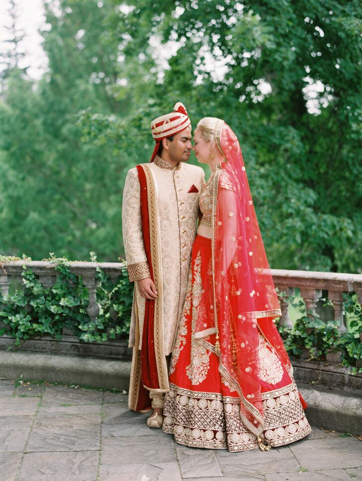 Couple in Traditional Indian Gold and Red Ceremony Attire