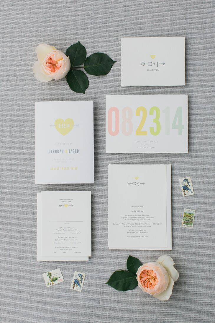 The wedding invitations printed on white stationery had colorful accents of gray and yellow that followed the day's palette. The piece with the wedding date written out in a colorful font stuck out the most, expressing the importance of the special day.