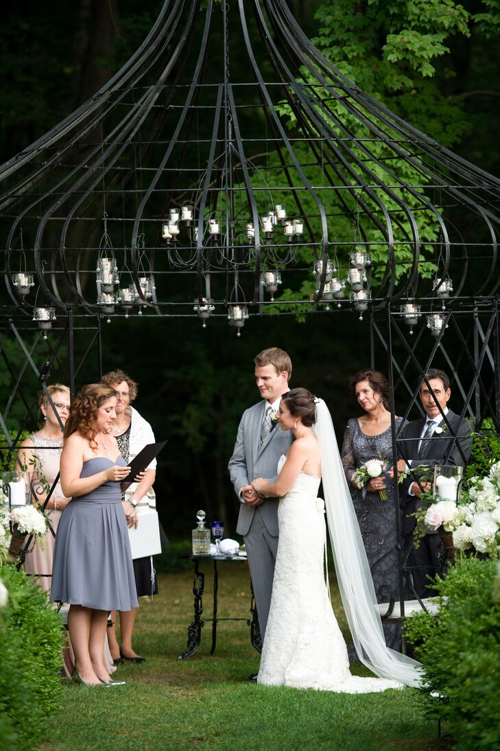 """Rachel and Jacob had planned on having their ceremony outdoors in the Lord Thompson Manor gardens, but the weather had other ideas in mind. Thirty minutes before the ceremony, it began to pour, leading the couple to believe they would be saying their """"I dos"""" indoors. But the staff at Lord Thompson Manor wasn't ready to let a little rain put a damper on the day. """"The staff at Lord Thompson Manor actually blow-dried the seats and even the grass, so we could have the ceremony outside,"""" Rachel says."""