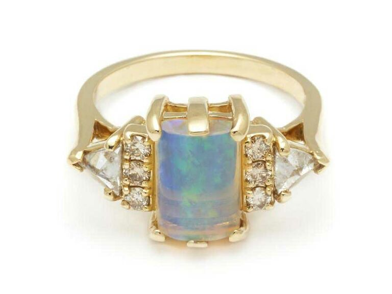 Gold and opal cabochon engagement ring