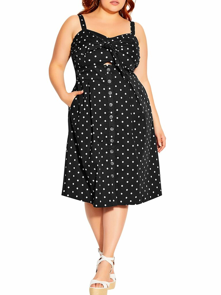 black and white polka dot midi dress with skinny straps and front cutout