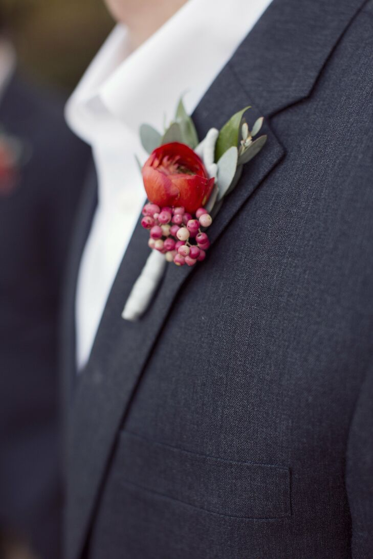 The groomsmen wore red rose boutonnieres accented with red berries.