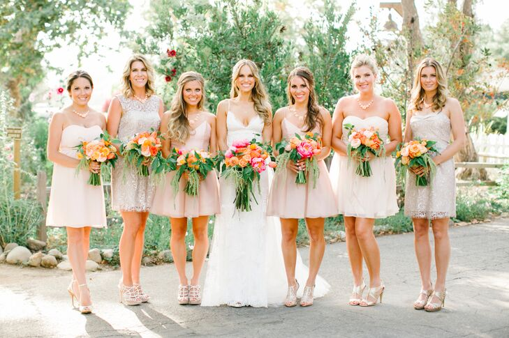Stacy's two sisters served as her maids of honor and wore matching blush-colored dresses designed by Jim Hjelm. All the other bridesmaids dressed in a variety of styles, brands and colors—from the lace champagne-colored Jenny Yoo dress to the off-white Love Lane chiffon dress.
