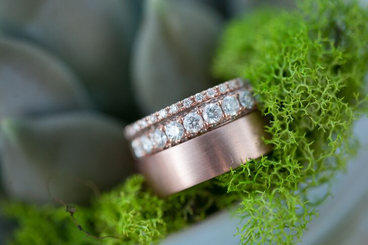 Since Megan and Marcus love the color copper, they knew they wanted rose gold wedding rings. They found the bands at Shane & Co. Megan's engagement ring is a rose gold band with pave diamonds and a matching smaller band. Marcus chose a matte rose gold band with a special message engraved on the inside.