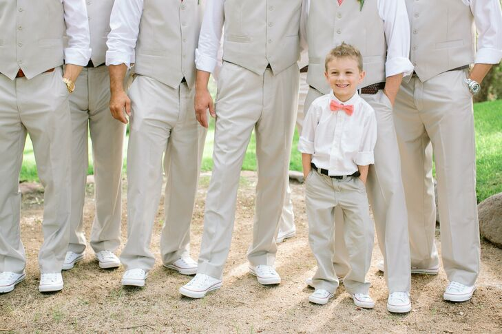 Jason and his groomsmen sported casual looks, wearing khaki pants with matching vests and bright white Converse sneakers. The youngest member of the bridal party opted out of the vest and wore a crisp white shirt and peachy-pink bow tie.