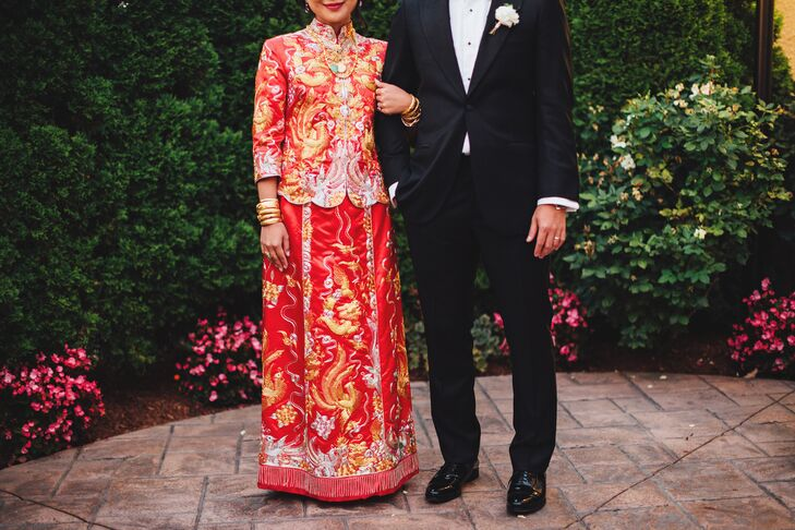 After the Western ceremony, Yan slipped out of her Pronovias wedding dress and into a traditional red and gold silk gown for the tea ceremony, which she had found on a trip to China.