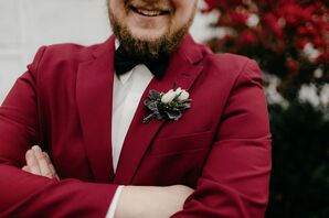 Groom in Burgundy Suit with Black Bowtie