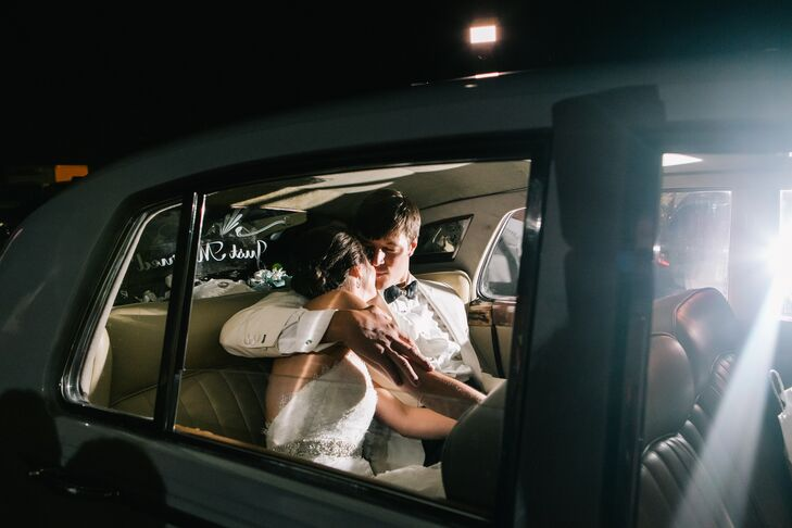 After leaving the reception at American Spirit Works, the couple left for their honeymoon at Grand Cayman. They shared a moment before leaving in a classic car.