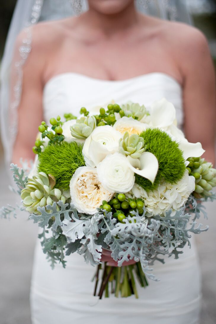 Lindsey carried a unique green bouquet of green dianthus, dusty miller, garden roses peonies and hypericum berries.