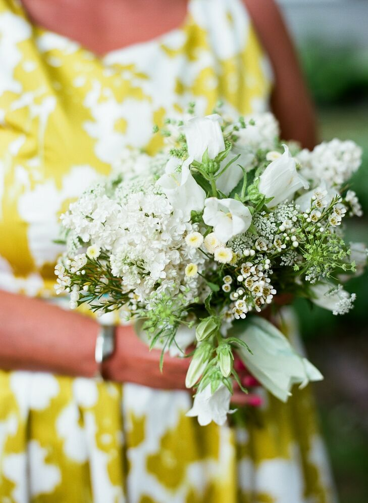 Fragrant white lilacs, button mums, wax flowers and other blooms were simple yet elegant additions to the bridesmaid bouquets.
