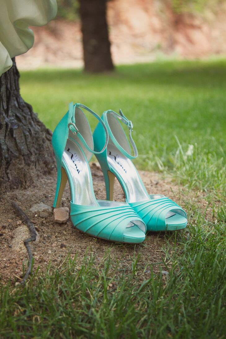 "Milena's favorite detail was her tiffany blue shoes. ""They added just a little pop of color,"" she says. Plus, they were a perfect something blue."