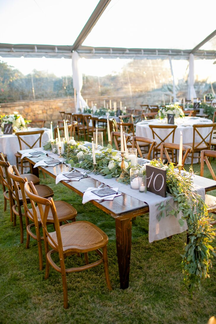 Chic Farm Tables with Taper Candles and Garland