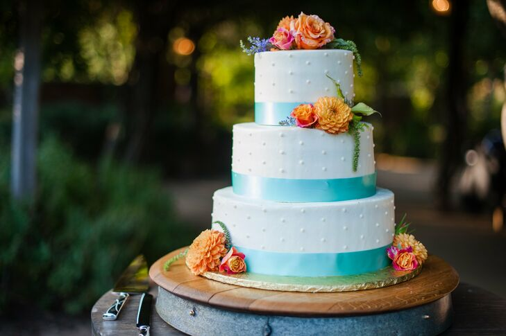 Bright flowers and colorful ribbon livened up the appearance of the couple's Swiss dot cake.