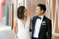 After hunting for a modern and minimal wedding venue, Christine Chyon and Randy Lee chose Dogpatch Studios in San Francisco, which serves as a working