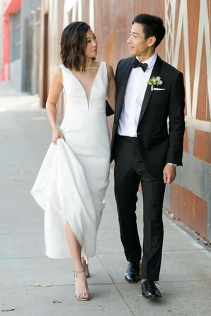 Elegant, Modern Couple with Formfitting Satin Wedding Dress and Black Tuxedo