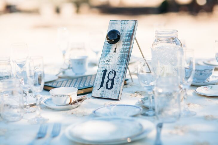 Monique and Shade created many of the details that decorated the space at Rancho San Antonio in Santa Ynez Valley, California, including the white slab of wood with a number written in black displayed at each table.