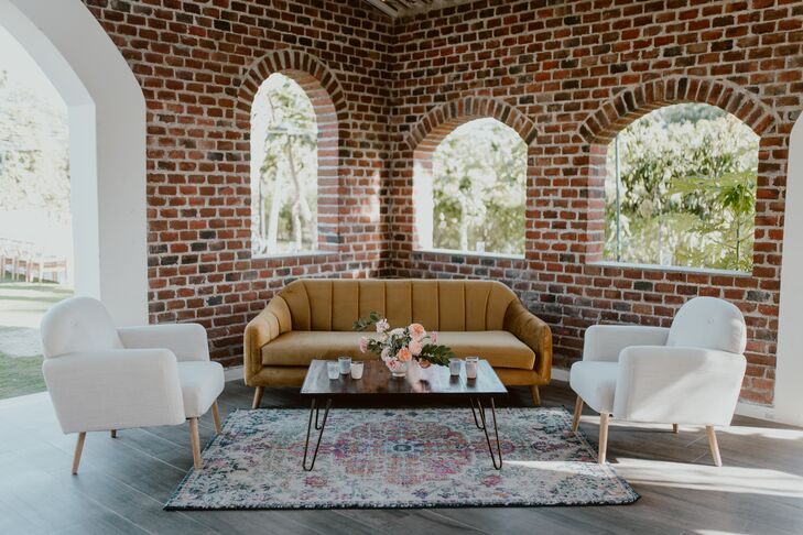 Modern Lounge Furniture with Brick Wall and Patterned Rug