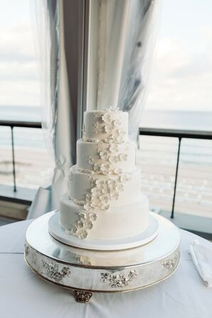 Elegant Tiered Wedding Cake with Flower Appliqués