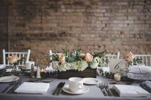 Dining Table with Soft Gray Linens and Peach and White Flowers