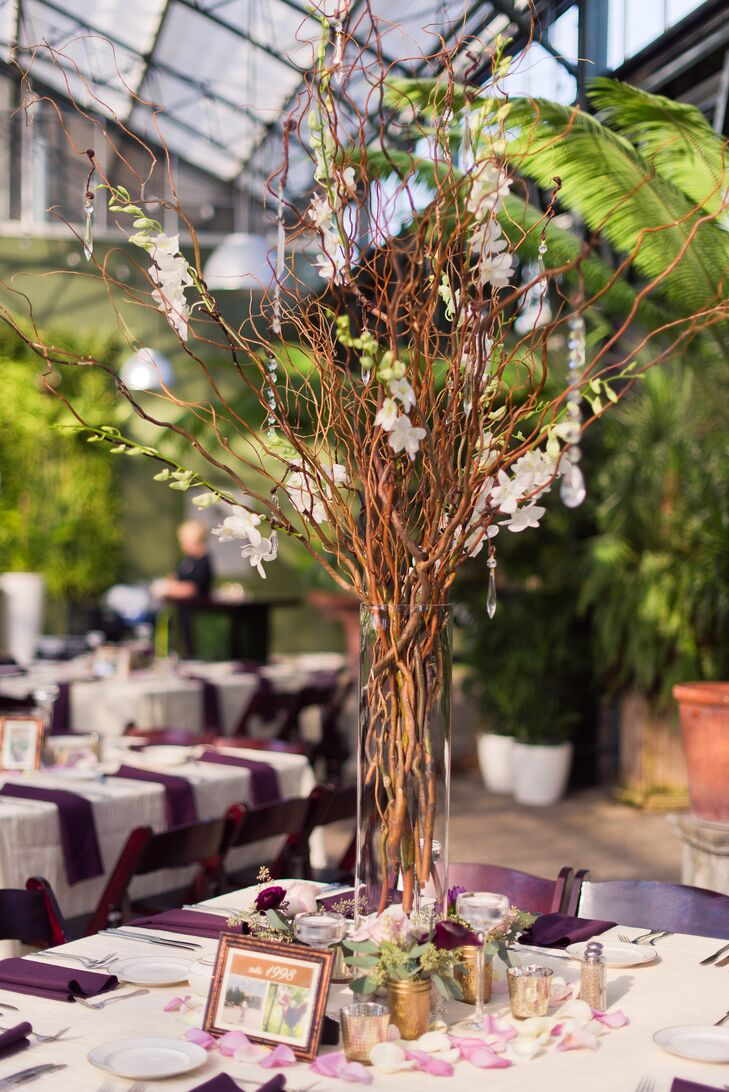Willow canopy with hanging crystals and hanging frosted votives served as just one of two types of centerpieces.