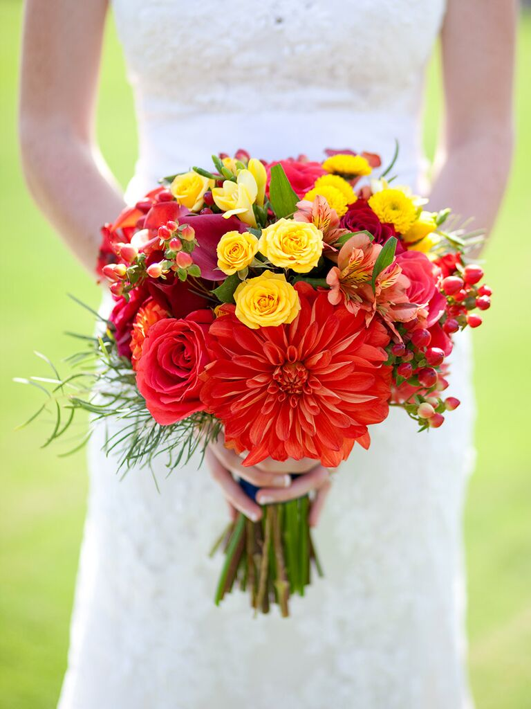 Red and yellow bouquet with dahlias, roses and button mums