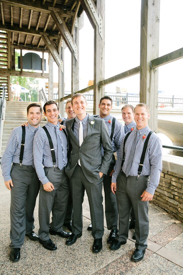 The groomsmen wore gray slacks with navy and white gingham-checkered shirts, gray ties and black suspenders. They added a pop of color to their look with pink boutonnieres. Matt went a little more formal with a suit jacket for the ceremony and a white tie to match Katie.