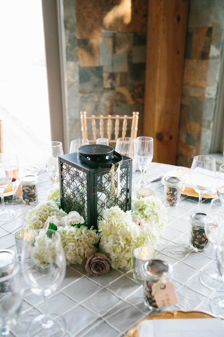 Lantern Centerpiece Surrounded by Hydrangea Clusters