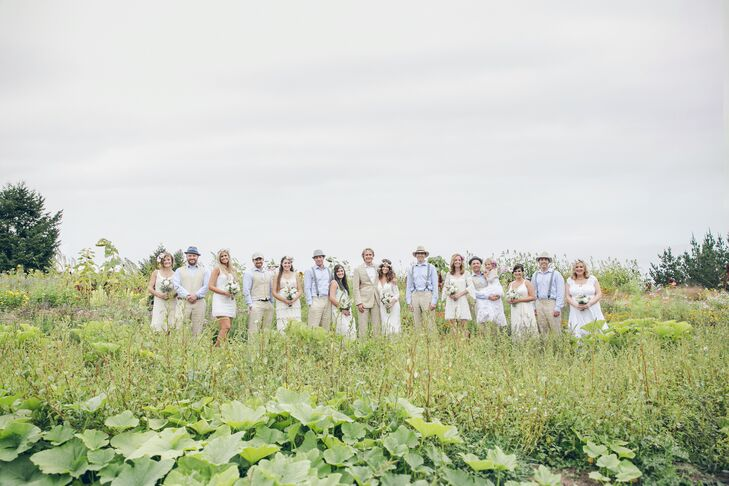 The wedding party embodied a soft color scheme filled with blues, whites and light brown. The bridesmaids embodied the bohemian style of the day with their various off-white dresses from thrift shops or Free People, while the groomsmen sported beige suits for the occasion.