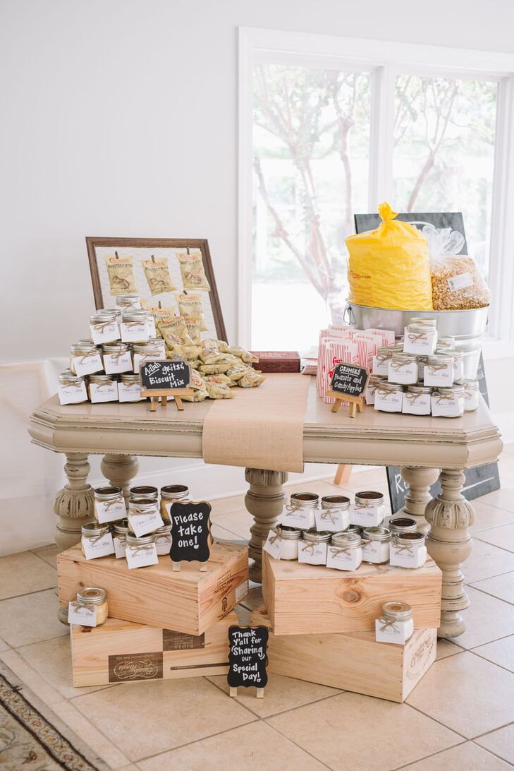 "Inspired by their desire to keep everything ""South Carolina,"" the couple arranged their favor display to look like an old country store filled with goodies. ""We jarred grits and biscuit mix from Adluh Flour company located in Downtown Columbia, SC along with recipes,"" says Stacy."