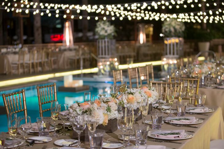 After the ceremony, the guests went inside for the cocktail hour and the outdoor area was transformed into the dinner reception area. All the tables were situated around the pool. The centerpieces consisted of peach and ivory roses accented with desert succulents in a wooden planter boxes.