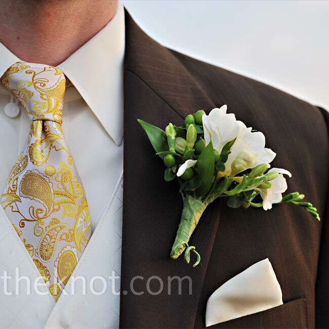 The boutonnieres were comprised of green hypericum and freesia -- white for Mike and yellow for the groomsmen.