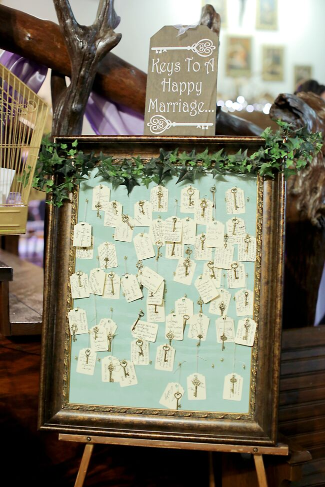 """As a place where their guests could leave well-wishes and wedding advice, the couple had an easel full of keys at their reception for their friends and family to leave the """"keys to a happy marriage."""""""