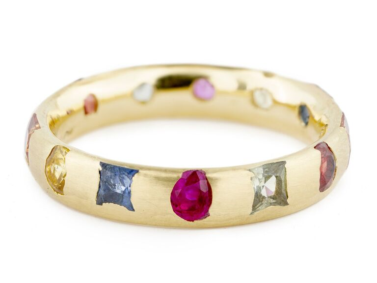 Engagement ring with Mixed cut, square and round green, red, orange, blue, and yellow sapphires on a narrow band
