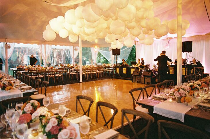French country chairs and wooden farm tables added some rustic flair to the tented reception—a nice contrast to the whimsical glow of the paper lanterns.