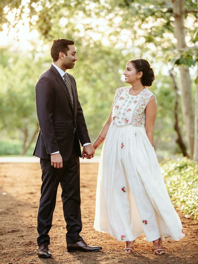 Bride wearing white floral Indian reception dress