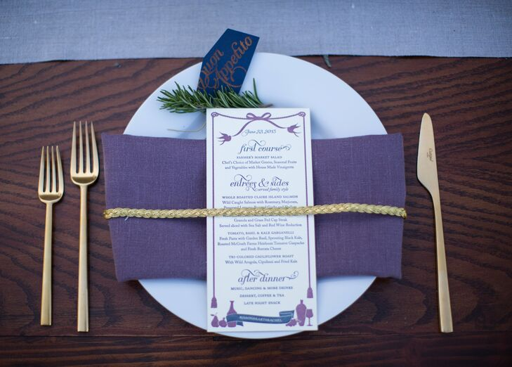 At their seats, guests found gold flatware and white plates topped with deep purple napkins and letterpressed menus, all wrapped with a gold braided cord.