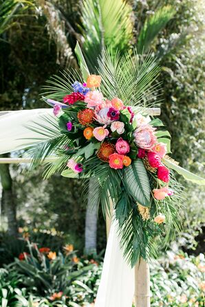 Vibrant King Protea, Ranunculus and Palm Leaf Wedding Arch Arrangement