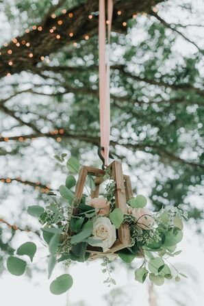 Hanging Wood Lanterns Filled With Roses and Greenery
