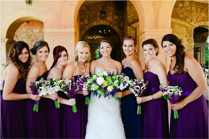 The bridesmaids wore  strapless dark purple dresses from the Wtoo by Watters collectio. The maid of honor wore a  a matching strapless dress but in blue. The entire bridal party accessorized with gold jewelry from the bride.