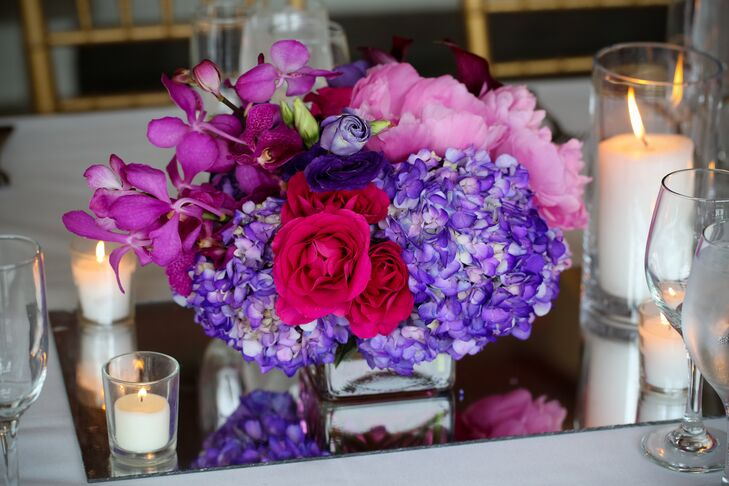 Fluffy arrangements of hydrangeas, orchids, garden roses, peonies and calla lilies topped tables.