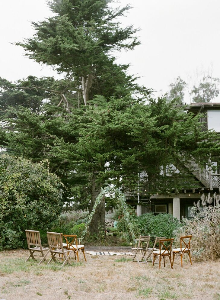Simple Backyard Wedding Ceremony With Wood Chairs