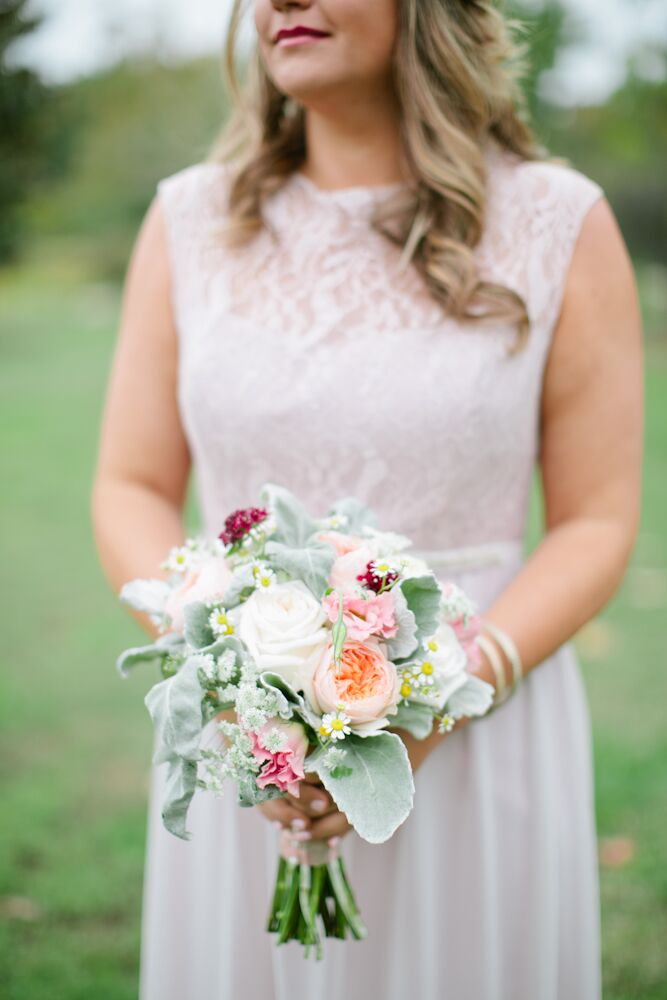 The bridesmaids carried lamb's ear, white roses, peach garden roses, Queen Anne's lace and wildflowers in their textured bouquets. Jessica loved how the lush florals reminded her of her mother's garden, which she loved to sit in when she was young.