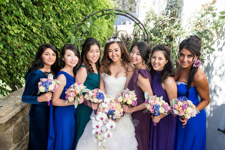 Kristy's bridesmaids wore a range of deep jewel-tone gowns to reflect the day's vibrant colors.