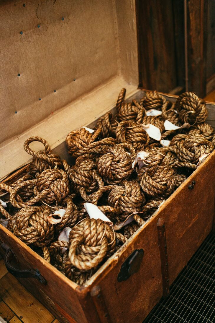 Monkey's fist knots (that the couple made!) were displayed in a vintage trunk for guests to take as favors.
