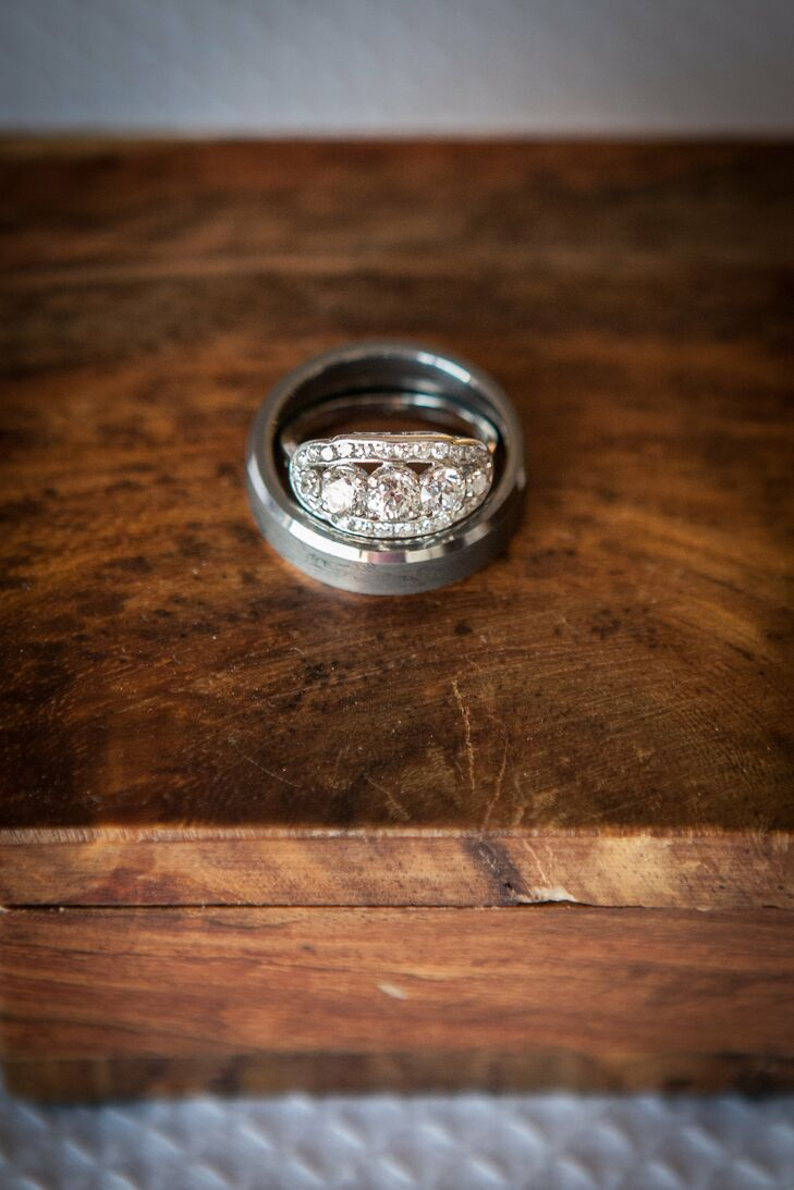 """""""The ring is a vintage piece from the estate area at Borsheim's in Omaha, Nebraska,"""" Laura says. """"We had looked at a few together, but Scott knew the one as soon as he saw it. The center diamond is an old mine cut from the 1800s, and the ring itself is from the 1950s. It's platinum and I have never seen anything like it."""""""