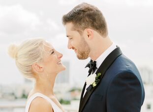 AshleyMcCauley and Tim Adleman had a classic formal celebration for their destination wedding. The ceremony took place in a Catholic church, and the