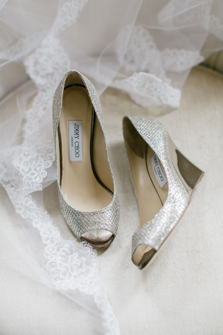 Since the wedding was outdoors, Kelsey opted for a wedge shoe to avoid sinking in the glass. Her Jimmy Choo shoes were metallic silver.