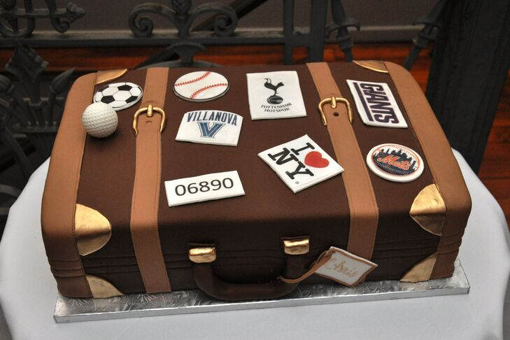 Chris's  combined all his favorite things—sports, schools and even cities—all on a suitcase-styled groom's cake with a gold luggage tag.